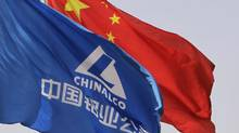 Aluminium Corp. of China (Chalco) flag and the Chinese national flag flutter outside its headquarters in Beijing, in this file photo. Chalco has dropped its $926-million bid for a majority stake in Mongolia-focused coal miner SouthGobi Resources Ltd. in the face of stiff political opposition. (CHRISTINA HU/REUTERS)
