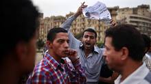 Egyptians argue about the elections at Tahrir Square in Cairo May 26, 2012. The Muslim Brotherhood and a military man close to ousted leader Hosni Mubarak courted defeated first-round candidates in Egypt's presidential election on Saturday, each trying to claim the mantle of the uprising before a run-off next month. (Suhaib Salem/Reuters/Suhaib Salem/Reuters)