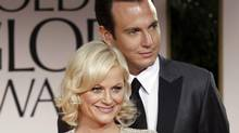 Amy Poehler, left, and Will Arnett arrive at the 69th Annual Golden Globe Awards in Los Angeles, Jan. 15, 2012. (Matt Sayles/AP)