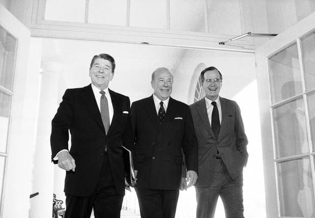 Secretary of State George Shultz, center, walks with President Ronald Reagan and Vice President George Bush on his arrival at the White House in January 1985 after two days of arms talks with the Soviet Union in Geneva.