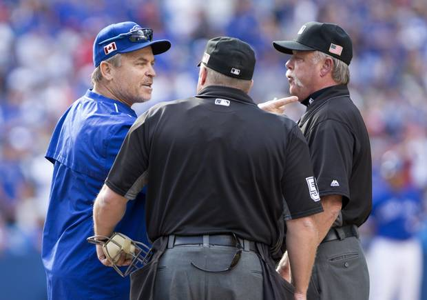 Toronto Blue Jays manager John Gibbons (5) argues with umpire crew chief Jim Joyce, right, and home plate umpire Marvin Hudson before being ejected during ninth inning Americain League MLB baseball action against the Boston Red Sox in Toronto on Sunday, September 11, 2016.
