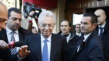 Italy's new premier-designate economist Mario Monti leaves the hotel to start talks with parties' representatives in Rome, Monday, Nov. 14, 2011. (Pier Paolo Cito/AP)