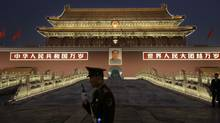 A Chinese police officer stands guard in front of Tiananmen Square in this 2009 file photo. (Vincent Thian/The Associated Press)