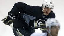 Pittsburgh Penguins captain Sidney Crosby (87) begins a rush up ice behind teammate James Neal during an informal workout with a dozen of the NHL team's players in Pittsburgh Monday, Jan. 7, 2013. (Gene J. Puskar/AP)
