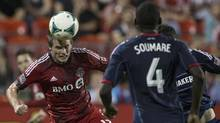 Toronto FC 's Justin Braun (left) gets ahead of the Chicago Fire defence to head on goal during second half MLS action in Toronto on Wednesday September 11, 2013. (Chris Young/THE CANADIAN PRESS)