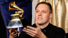 Win Butler of Arcade Fire holds up the Grammy for Album of the Year. (Kevork Djansezian/Getty Images)