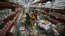 Customers shop inside a Best Price Modern Wholesale store, a joint venture of Wal-Mart Stores Inc. and Bharti Enterprises, at Zirakpur in Punjab Nov. 24, 2012. (Ajay Verma/Reuters)