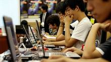 South Korean computer hackers compete during an information security olympiad at the National Assembly in Seoul, South Korea, Friday, July 10, 2009. (Lee Jin-man)