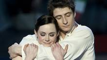 Ice dance gold medalist Canada's Tessa Virtue and Scott Moir embrace during victory ceremonies Friday March 26, 2010 at the World Figure Skating Championships in Turin, Italy. (Paul Chiasson/Paul Chiasson/The Canadian Press)