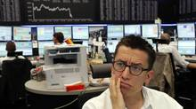 A broker watches his monitor at the Frankfurt stock exchange Friday July 6, 2012. (Mario Vedder/AP)