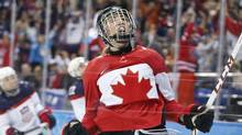 Meghan Agosta-Marciano of Canada celebrates her second goal against the United States during the 2014 Winter Olympics women's ice hockey game at Shayba Arena, Wednesday, Feb. 12, 2014, in Sochi, Russia. (Associated Press)