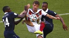 Germany's Thomas Mueller fights for the ball with France's Blaise Matuidi, left, and Patrice Evra during their 2014 World Cup quarter-finals at the Maracana stadium in Rio de Janeiro July 4, 2014. (Reuters)