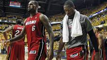 Miami Heat's LeBron James and Dwyane Wade, right, leave the court after losing 94-75 to the Indiana Pacers in Game 3 of their NBA basketball Eastern Conference semi-final playoff series, Thursday. (Darron Cummings/Associated Press)
