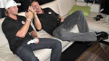 Hockey stars Steven Stamkos (left) and Jeremy Roenick celebrate a goal while playing EA Sports NHL 12 during an exclusive Xbox holiday preview event in Toronto, Thursday, August 18, 2011. The Canadian Press Images PHOTO/Xbox Canada (Xbox Canada/CP)