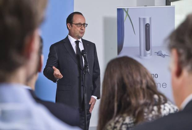 French President Franocis Hollande delivers a speech as he visits a tech company in Boulogne-Billancourt, outside Paris, on April 4, 2016.