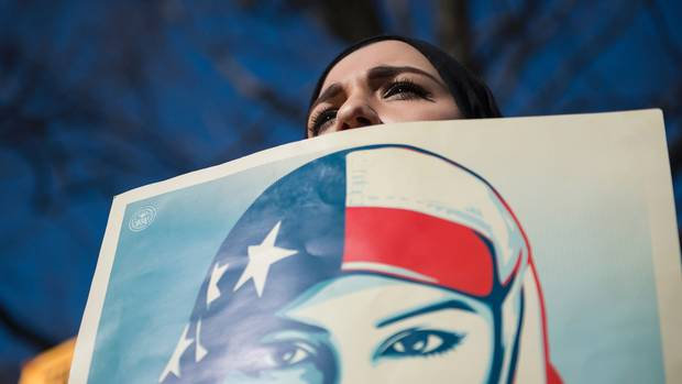 Isra C., of Washington, D.C., who did not want to give her last name, takes part in a protest outside the White House on Feb. 4, 2017.