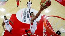 Canada's Cory Joseph scores against Puerto Rico during a FIBA World Cup qualifying basketball game in Caracas, Venezuela, Saturday, Aug. 31, 2013. Joseph scored 17 points on Tuesday as Canada beat Uruguay 93-67. (FERNANDO Llano/AP)