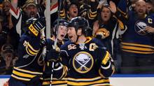 Buffalo Sabres celebrate a second period goal by defenseman Craig Rivet during second period action against the Boston Bruins during their NHL Eastern Conference quarter-final in Buffalo, New York April 15, 2010. (ADAM WIEPERT/REUTERS/Adam Wiepert)