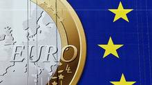 A section of the giant euro banner, featuring an image of a euro coin and promoting stronger European economic governance, hangs on the side of the headquarters of the European Union commission at the Berlaymont Building, in Brussels, Belgium on Nov. 21, 2011. (Jock Fistick/Bloomberg)