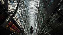 A woman walks through Brookfield Place off Bay Street, on the day of their annual general meeting for shareholders in Toronto, May 7, 2014. (Mark Blinch/Reuters)