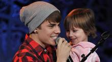 Justin Bieber and his sister Jazmyn perform during a special acoustic Christmas show at Massey Hall in Toronto. (George Pimentel/Getty Images/George Pimentel/Getty Images)