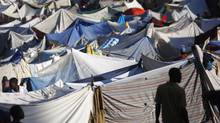 A man walks at a makeshift refugee camp in Port-au-Prince January 19, 2010. (JORGE SILVA/REUTERS)