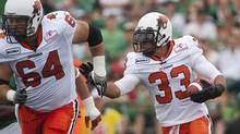 BC Lions running back Andrew Harris runs the ball during the second quarter of CFL action between the Saskatchewan Roughriders and the BC Lions in Regina on Saturday, July 14, 2012. (Liam Richards/THE CANADIAN PRESS)