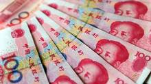 This November 12, 2010 file photo shows an illustration of Chinese currency 100 yuan notes issued by the People's Bank of China, fronted with an image of former Communist party leader Mao Zedong and on the rear, the parliament building Great Hall of the People, in Beijing. (Frederic J. Brown/AFP/Getty Images/Frederic J. Brown/AFP/Getty Images)