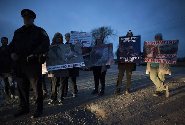 Protesters from the Animal Alliance of Canada march by the barricade outside Short Hills Provincial Park on Dec. 4, 2017, where members of the Six Nations of the Grand River were harvesting deer in the closed park.