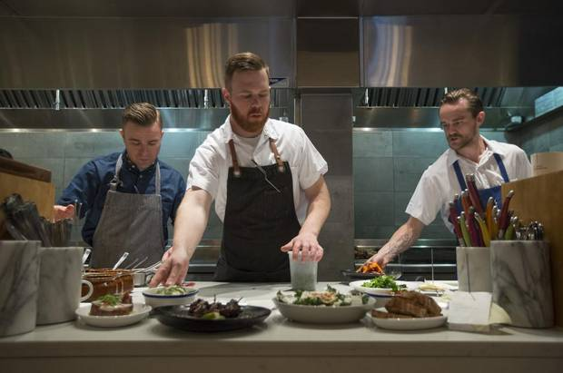 Stephen Smee, executive chef and owner; Andrew Moore, chef de cuisine; and Neil Maclean work the line at Ten Foot Henry.