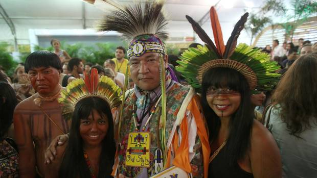Lamarr Oksasikewiyin from Treaty 6 territory in Saskatchewan poses for pictures with indigenous Brazilians after performing Cree traditional dances for a crowd in Palmas, Brazil, at the first World Indigenous Peoples Games on Oct. 28, 2015.