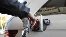 A driver fills his car with gasoline. (Fred Lum/The Globe and Mail)