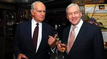 Conrad Black, right, and Former Ont. Lt. Gov. Henry Jackman chat at Grano Bistro in Toronto, Tues. Feb. 7, 2006. (Tom Sandler/The Canadian Press)
