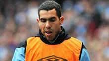 Manchester City's Argentinian striker Carlos Tevez is pictured on the side-lines during the English Premier League football match between Manchester City and Everton at Etihad Stadium in Manchester, north-west England on September 24, 2011. (CARL DE SOUZA/AFP/Getty Images)