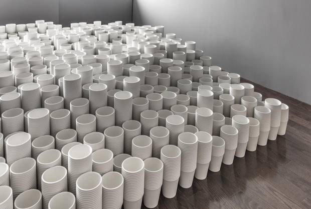 Visitors to Roula Partheniou's exhibit Cup and Ball in Toronto first encounter a hill of what look like Dixie cups, arranged in a tidy grid of undulating stacks.