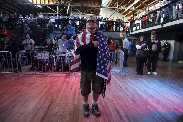 Supporter Jansen Tropf wears an American flag at a campaign rally for Donald Trump in Salt Lake City, Utah in March.