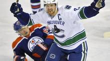 Vancouver Canucks' Henrik Sedin celebrates the winning goal against the Edmonton Oilers during overtime of their NHL game in Edmonton February 4, 2013. Edmonton Oilers' Nail Yakupov lies on the ice behind Sedin. (DAN RIEDLHUBER/REUTERS)