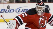 New Jersey Devils goalie Martin Brodeur deflects a shot from the Ottawa Senators in the first period of their NHL hockey game in Newark, New Jersey, February 18, 2013. (Reuters)