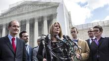Plaintiff Sandy Steier, center, flanked by other plaintiffs and attorneys, talks to reporters outside the U.S. Supreme Court in Washington, March 26, 2013. (BRENDAN HOFFMAN/NYT)