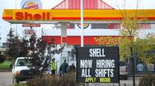 A service station in Fort McMurray, Alta., advertises for workers in this photo from August, 2010. (Kevin Van Paassen/Kevin Van Paassen/The Globe and)
