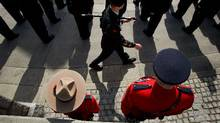 An active member of the Royal Canadian Mounted Police, left, and a An active Mountie, left, and a retired Mountie, right, watch as cadets are inspected during a Vimy Day ceremony at Victory Square in Vancouver on April 9. Darryl Dyck (Darryl Dyck/The Canadian Press/Darryl Dyck/The Canadian Press)