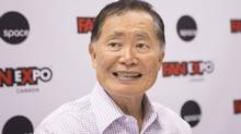 Former Star Trek actor and gay-rights activist George Takei signs autographs for fans at Fan Expo in Toronto on Friday August 23, 2013. (Chris Young/THE CANADIAN PRESS)