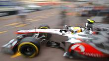McLaren Formula One driver Lewis Hamilton of Britain leaves the pit during the second practice session of the Monaco F1 Grand Prix May 24, 2012. (MAX ROSSI/MAX ROSSI/REUTERS)