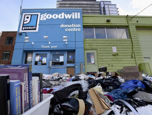 Heaps of goods were left outside the Richmond Street Goodwill after the closure of all 16 Toronto-region stores was announced.