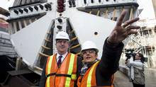 Transportation Minister Glen Murray, left, stands with Laura Albanese, MPP for York South-Weston in front of the Tunnel Boring Machine as politicians speak to the media about the new Eglinton Crosstown construction site in Toronto on Tuesday April 9, 2013. (Chris Young For The Globe and Mail)