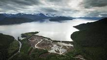 Workers clear the land at the Kitimat LNG site on the Douglas Channel that leads out to the Pacific Ocean. Natural gas will be delivered via a pipeline and then loaded on to a ship headed for Asia. (JOHN LEHMANN/THE GLOBE AND MAIL)