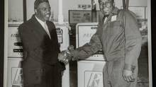 """Tuesday, April 23, 2012 - Calgary, Alberta - A photograph of baseball legend Jackie Robinson (left) and Ezzrett """"Sugarfoot"""" Anderson taken in 1955 at the Royalite Service Station, which Anderson owned at the time in Calgary, Alberta. (Chris Bolin/Photos by Chris Bolin for The Gl)"""