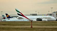 An Emirates Air jet sits at the terminal at Toronto's Pearson airport on Nov. 19, 2010. (J.P. MOCZULSKI/J.P. Moczulski for The Globe and Mail)