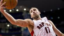 Toronto Raptors' Jonas Valanciunas grabs a rebound against the Detroit Pistons during preseason NBA action in Toronto on Friday, October 12 2012. (Aaron Vincent Elkaim/THE CANADIAN PRESS)