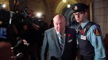 Senator Mike Duffy arrives at the Senate on Parliament Hill October 28, 2013 in Ottawa. (Dave Chan For The Globe and Mail)
